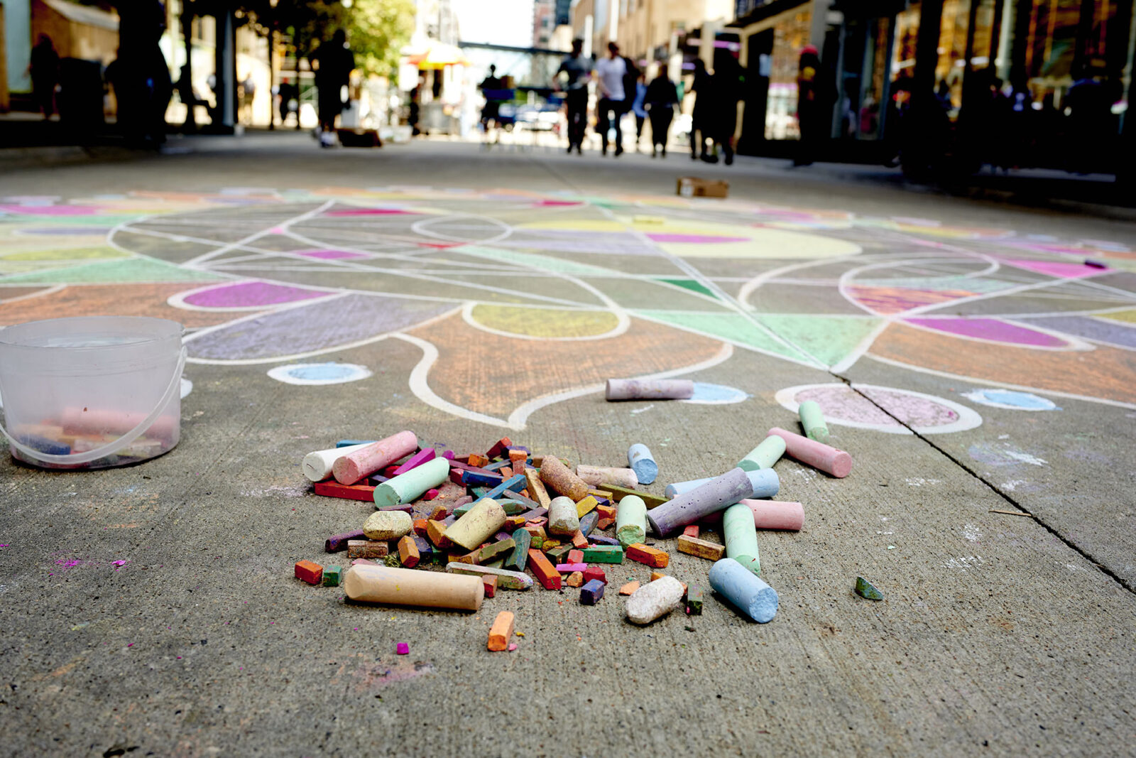 A community chalk mandala in progress during the 2019 Minneapolis Street Art Fest on Nicollet Mall. Tony Nelson Photography